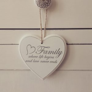 White wooden sign, Family where life begins and love never ends