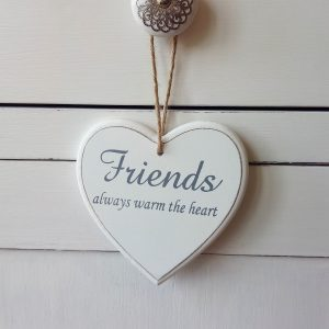 White wooden sign - Friends always warm the heart